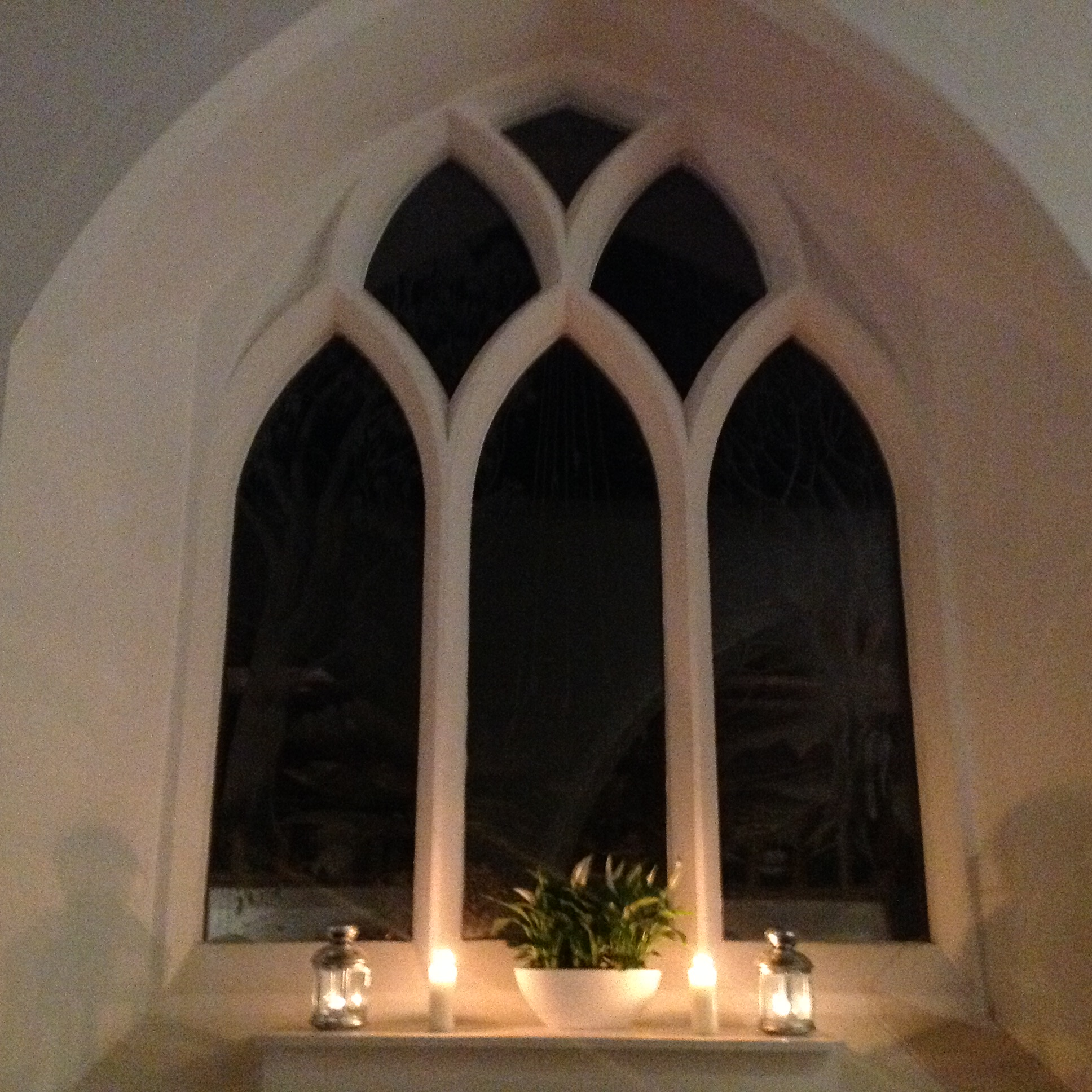 The candlelit Laurence Whistler Window